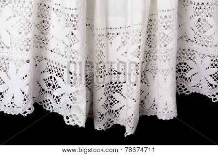 Isolated view on the lace edge of a catholic priest surplice