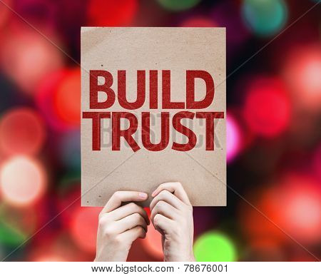 Build Trust card with colorful background with defocused lights