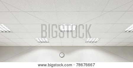 Fluorescent lamp on the modern ceiling and wall