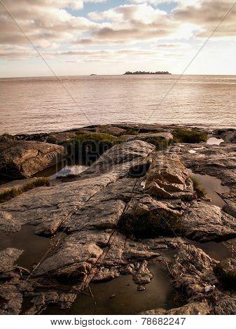 Rocks And Sea At Colonia