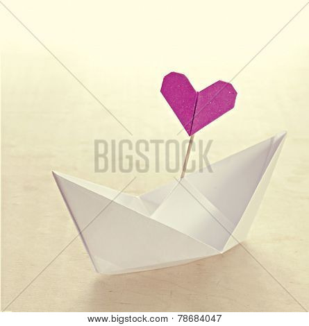 Origami boat with heart flag