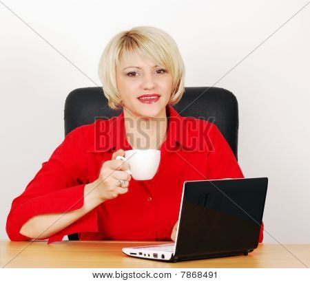 business woman with coffee and laptop