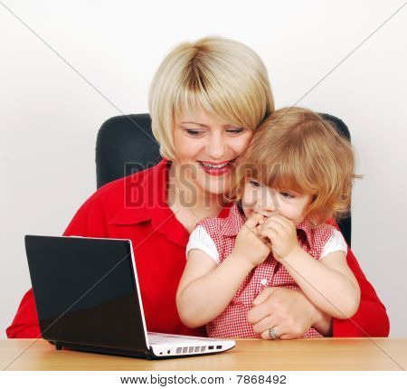 daughter and mother with laptop