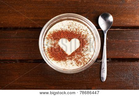 sweet grits with cocoa heart on top