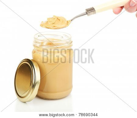 Creamy peanut butter in jar, isolated on white