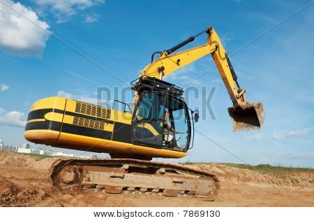 Loader Excavator Moving In A Quarry