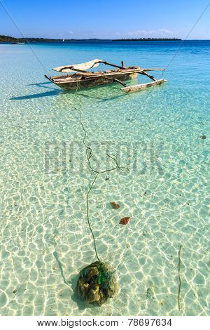 Traditional Fisherman Boat Lying Near The Beach In Clear Water