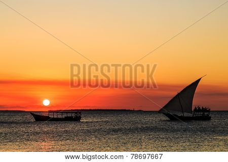 Tourist On A Traditional Fishermans Boat Watching The Sunset