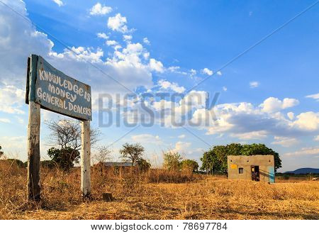 Road Sign Along The Road In African Village