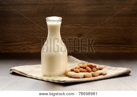 Almond Milk In Bottle With Raw Almonds