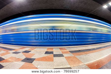 Blue Subway Train In Motion At The Underground Station. Wide Angle