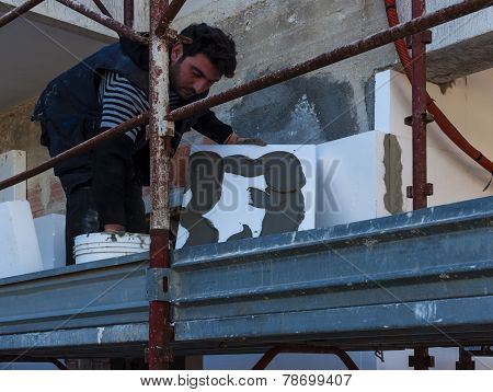 Installing external insulation Facade therm