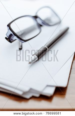 Glasses And Pen On White Paper For Notes
