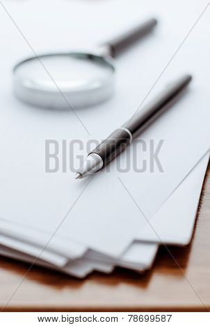 Magnifying Glass, Ballpoint Pen On White Paper For Notes