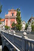 City with main bridge tromostovje and a church poster
