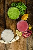 stock photo of vanilla  - Healthy smoothie - banana-vanilla pomegranate and orange spinach and herbs ** Note: Soft Focus at 100%, best at smaller sizes - JPG