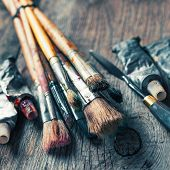 foto of knife  - Artistic paintbrushes tubes of oil paint palette knife on old wooden desk - JPG