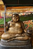 pic of gautama buddha  - happy Buddha statue represent of lucky and wealthy - JPG