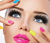stock photo of nail  - Beauty Girl Portrait with Vivid Makeup and colorful Nail polish - JPG