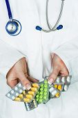 picture of placebo  - a young doctor prescribes medication - JPG