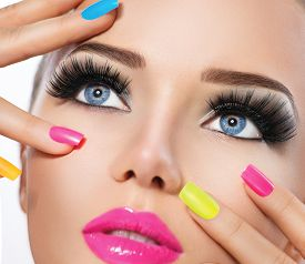 stock photo of foundation  - Beauty Girl Portrait with Vivid Makeup and colorful Nail polish - JPG