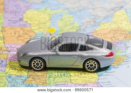 Closeup car (small) toys on paper map