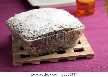 Cheesecake with poppy seeds topped with powdered sugar
