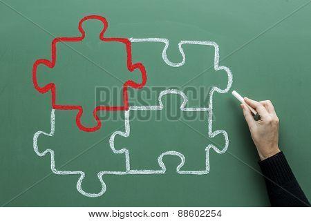 Jigsaw Drawing On Blackboard
