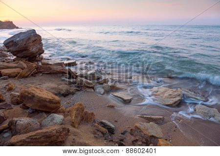 beautiful sunrise landscape,  the rocky sea coast and water waves