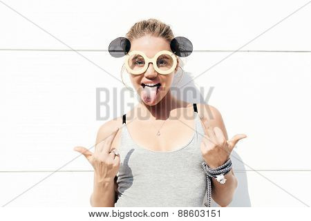 Young Blonde Woman In Sunglasses Showing Middle Finger