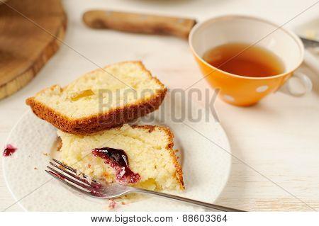Mascarpone Cake Slice, Cup Of Tea In Orange Teacup, Table Knife, Blueberry Jam On White Bright Backg