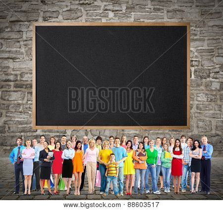 Large smiling People group near blackboard background.