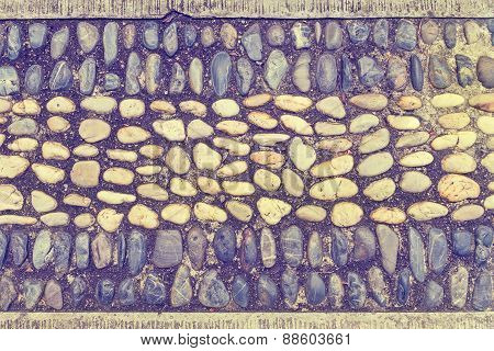 Pebbles Arranged On The Wall Vintage Color