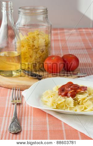 Farfalle With Tomato Sauce On White Dish