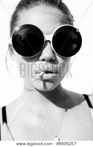 Portrait Of  Sexy Woman In Sunglasses With Cigarette