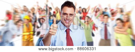 Happy young businessman near people group background.