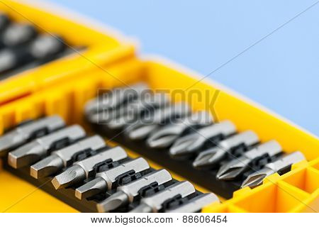 Closeup on phillips and robertson screwdriver insert bits of various sizes