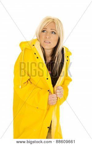 Scared Woman In Yellow Rain Coat