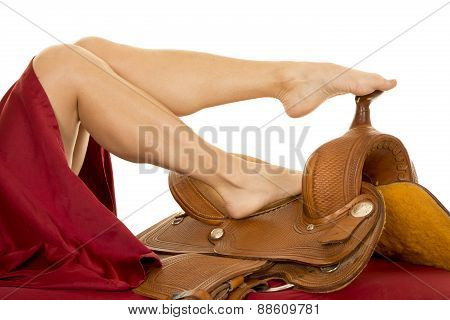 Woman Legs On Saddle Toes On Horn
