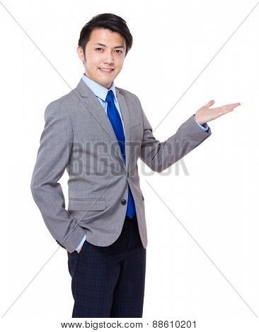 Asian business man standing with open hand