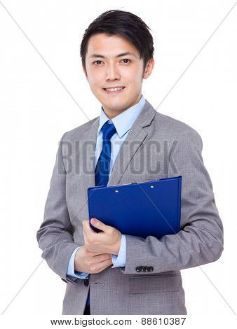 Asian businessman hold the file pad