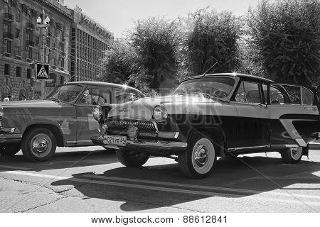 GAZ M-21 at the exhibition of vintage cars. Black & white photo