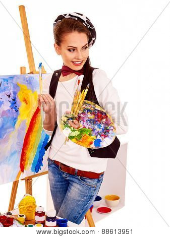 Artist woman at work. Isolated. Picture on easel.