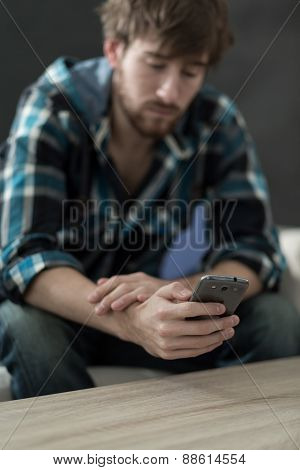 Careless Man Holding Phone