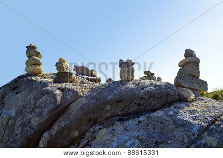 Stones balancing on top of Foia the highest mountain of Algarve, Portugal.