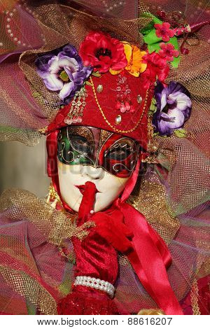 Participant at the annual venitian carnival of Annecy,