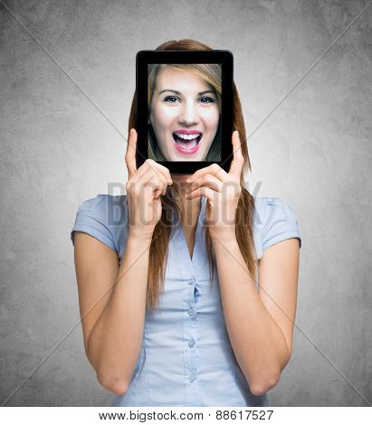 Portrait of a woman holding a digital tablet