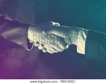Handshake Handshaking dark and light