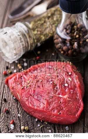 Beefsteak on a wooden board