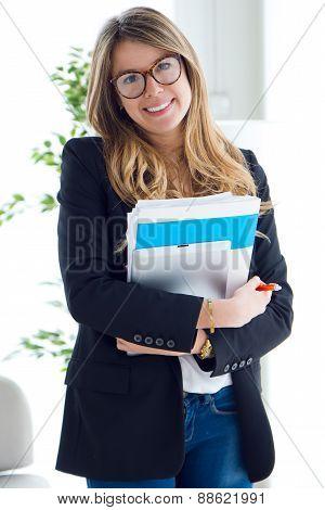Beautiful Young Business Woman Looking At Camera.